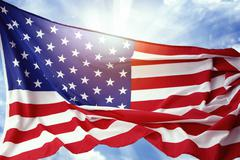 Stock Photo of american flag in front of blue sky