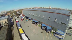 Trucks parked near warehouse on territory of Automobiles Plant Stock Footage