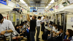 Train Passengers Riding a Busy Subway Car - Tokyo Metro Rail System Stock Footage