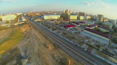 Cityscape with railroad at evening during sunset. Aerial view Stock Footage