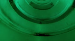 Boy climbs in green tube of playground construction. Head view Stock Footage