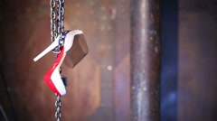 One female shoes with a high heel hanging on circuits Stock Footage