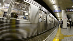 Subway Train Exits the Station at Japan Metro Rail Station Stock Footage