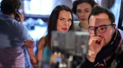 Director with assistant and model looking preview footage Stock Footage