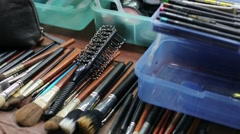 Cosmetics and different make-up equipment in dressing room Stock Footage