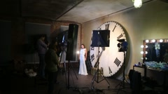 Shooting music video with Eugeniya Vershanskaya near clock Stock Footage