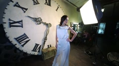E.Vershanskaya posing near clock during shooting video clip Stock Footage