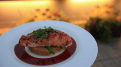 savory on plate: roast golden fish served with red sauce and asparagus - stock footage
