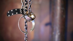 Bracelets and bijouterie hanging on a metal chain in the studio Stock Footage