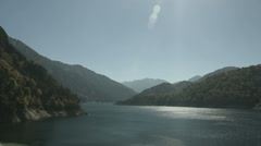 Lake Kurobe zoomed up, non color graded Full HD (1920x1080) Stock Footage