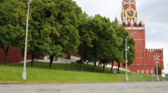 Little girl goes with compass near Spasskaya tower on Red Square Stock Footage