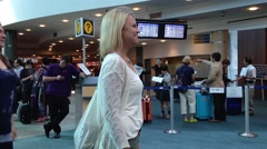 Woman waiting for her friend at internation arrival lobby Stock Footage
