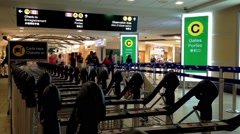People waving with their family in front of boarding gate Stock Footage