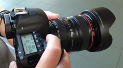 Before photographer takes pictures with dslr camera. Stock Footage