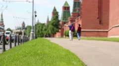 Back of tourists (out of focus) walking near walls of Kremlin Stock Footage