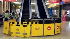 Shut down escalator with maintenance sign inside shopping mall Stock Footage