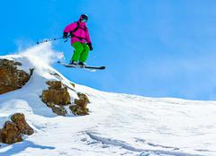 Skier jumping off a cliff Stock Photos
