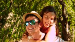 Happy Couple Piggyback Ride Outdoors Park Happiness Concept Stock Footage