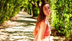 Summer Forrest Tree Tunnel Woman Walking Path Road to Happiness Stock Footage