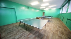 Small empty room for table tennis with green walls Stock Footage