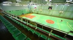 Women play tennis in sport hall of Kolontaevo sanatorium. Stock Footage