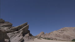 Cool jagged rock in desert time lapse Stock Footage