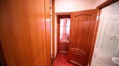 Wooden corridor and white toilet and shower cabin Stock Footage