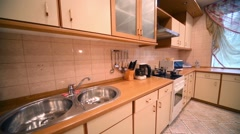 Modern wash and table in empty kitchen in apartment - stock footage