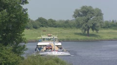 Inland ship transporting sand in a bend of river Meuse near Heerewaarden Stock Footage