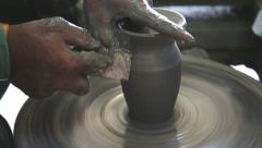 Hands working clay on potter's wheel Stock Footage