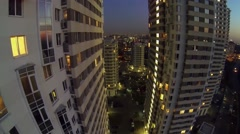 Residential complex with illumination against megalopolis - stock footage