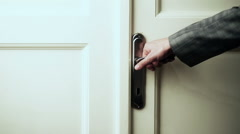 Male hand in gray suit opening the door - stock footage
