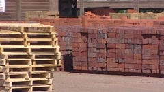 Pan brickyard with stockpiles of traditional manufactured bricks. Stock Footage