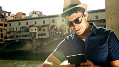 Stock Video Footage of Young Tourist Businessman Working tablet Mobile Technology Wifi Future Concept
