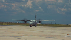 Military transport airplane taxiing on runway. Stock Footage