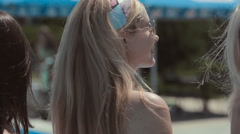 Hot girls turn around and posing near the poolside Stock Footage