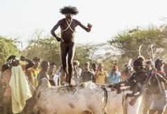 Turmi, omo valley, ethiopia - december 30, 2013: unidentified young man jumps Stock Photos