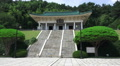 Man Walks Up Stairs At Chungnyeolsa Sacred Shrine Busan South Korea HD Footage