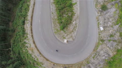 Sharp corner downhill with skaters riding through Stock Footage