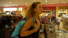 Blond Curly Shopaholic Woman Walking in Shopping Center. - stock footage