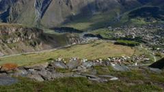 4K UHD Village of Gergeti and mount Kazbek in Georgia tilt up Stock Footage