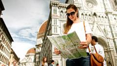 Fashionable Young Female Model Looking for Directions Map Florence Stock Footage