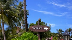 WC Sign on the Beach with Palm Trees. Toilet Sign in Tropics. Stock Footage