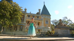 Ballerina in the old park of the palace   (with model release) Stock Footage
