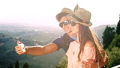 Attractive Tourist Couple Outdoors Vacation Nature taking Selfie Smiling Stock Footage