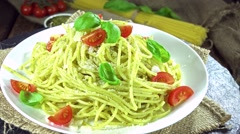Pasta with pesto sauce (loopable) Stock Footage