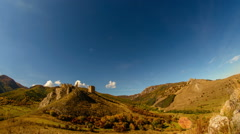 Coltesti fortress in autumn landscape time lapse with airplane trails Stock Footage