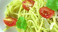Spaghetti with pesto sauce (loopable) Stock Footage