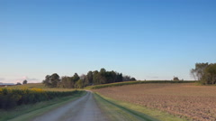 Driving back road in Midwest corn belt at dusk - stock footage