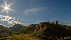 Coltesti fortress in autumn landscape time lapse with sun HD Stock Footage